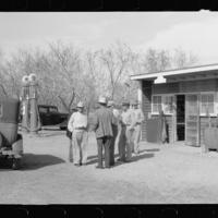 Untitled photo, possibly related to, Migrantory worker at coop store gas station, FSA Farm Security Administration camp, Weslaco, Texas.jpg